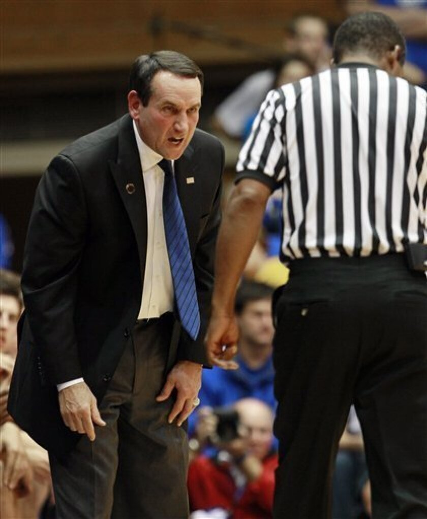 Duke coach Mike Krzyzewski, left, speaks with an official during the second half of an NCAA exhibition college basketball game against Cal Poly Pomona in Durham, N.C., Thursday, Nov. 4, 2010. Duke won 81-60. (AP Photo/Gerry Broome)