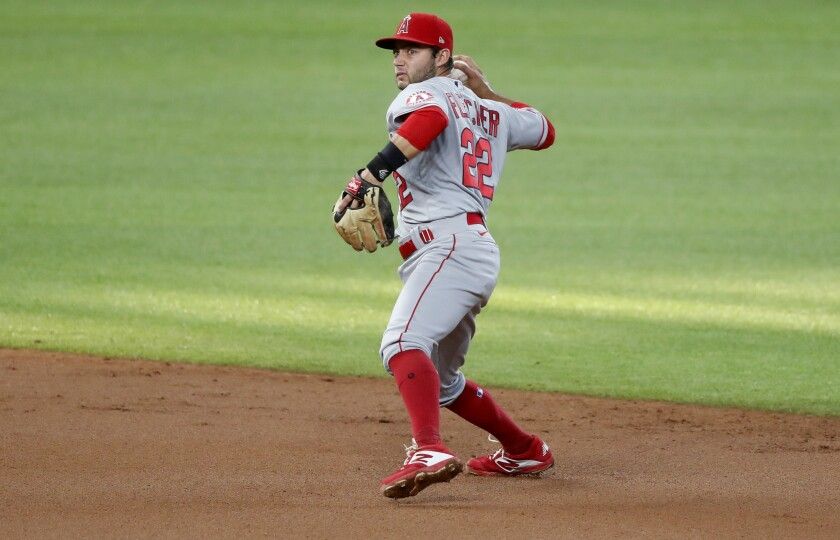 Angels shortstop David Fletcher throws to first during a game against the Texas Rangers on Aug. 8.