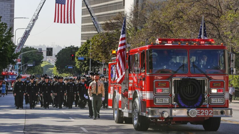 One year after a firefighter's deadly fall, L A  is fighting