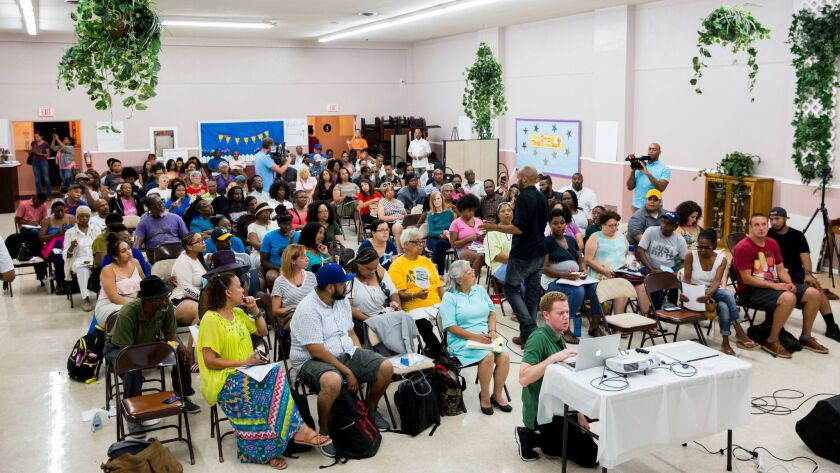 People gather for a town hall meeting to discuss gentrification and the Baldwin Hills Crenshaw Plaza
