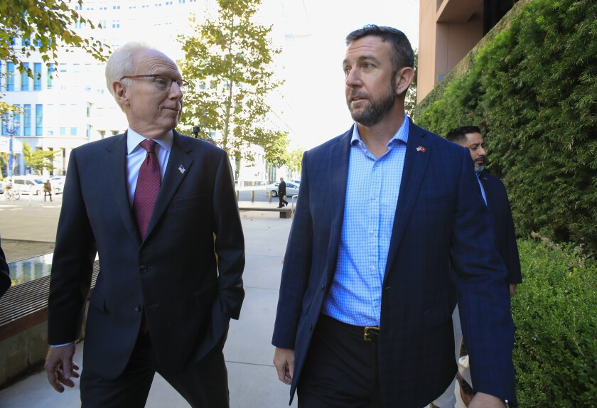 Congressman Duncan Hunter arrives to U.S. District Court Monday, Nov. 25, 2019 with his attorney Paul Pfingst.