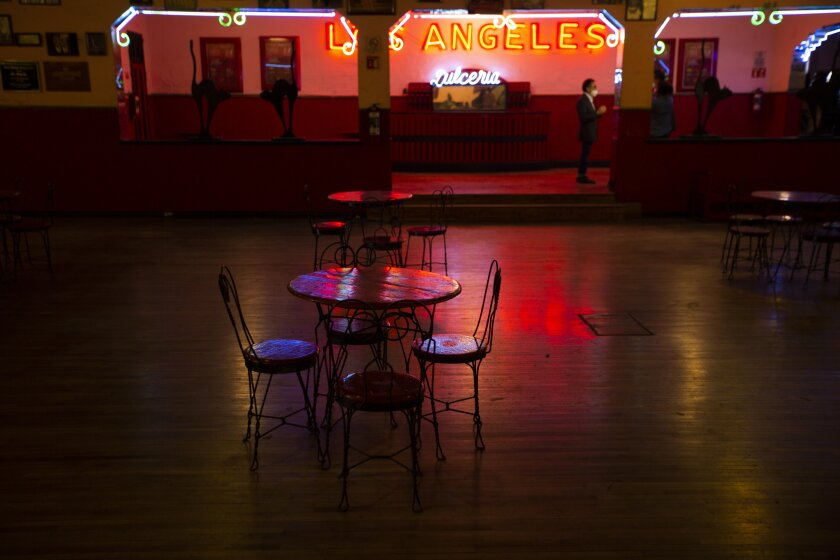 "Tables and chairs sit the empty Salon Los Angeles during an event to raise money and keep open the iconic dance hall known as ""The Cathedral of Mambo"" amid the new coronavirus pandemic in Mexico City, Saturday, Sept. 5, 2020. Millionaires, writers, ambassadors, and movie stars danced here; now, shuttered for more than five months due to the pandemic, the owners of the fabled hall say they are in debt and may have to close and demolish it. (AP Photo/Fernando Llano)"