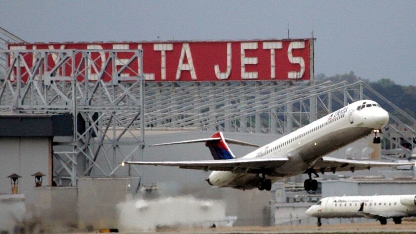 **FILE** In this April 14, 2008 file photo, a Delta Airlines jet departs Hartsfield Jackson Atlanta