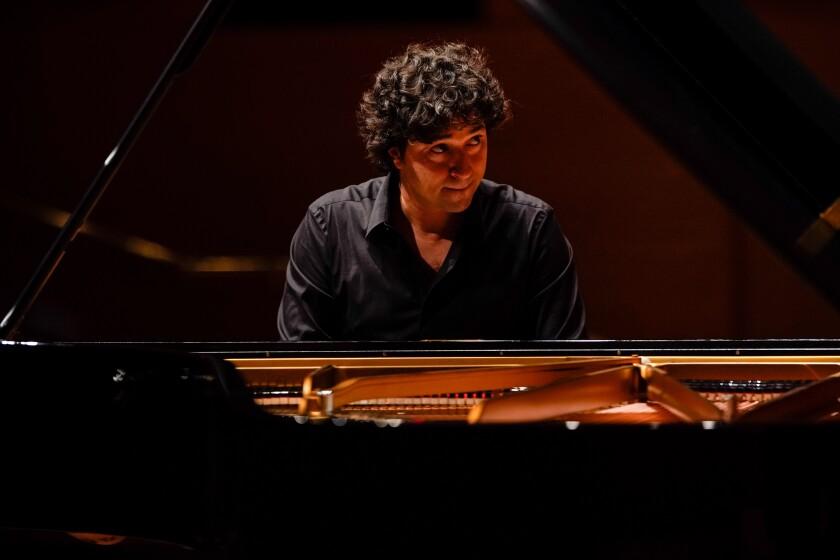 Sergio Tiempo performs with the L.A. Phil in the world premiere of Esteban Benzecry's Piano Concerto at Disney Hall.