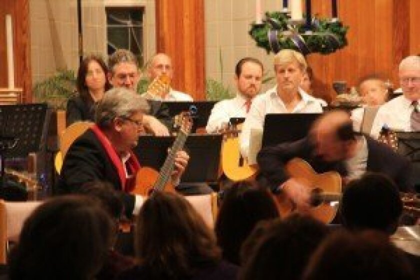 Each four-month session of the Encinitas Guitar Orchestra, directed and founded by Peter Pupping, ends with a public performance. Courtesy photo