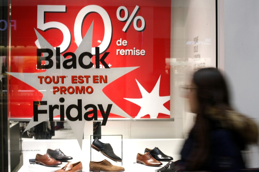 A business offers Black Friday bargains in Paris on Nov. 29. People don't celebrate the Thanksgiving holiday in Europe, but the Black Friday shopping phenomenon has spread to retailers across the Atlantic in recent years.