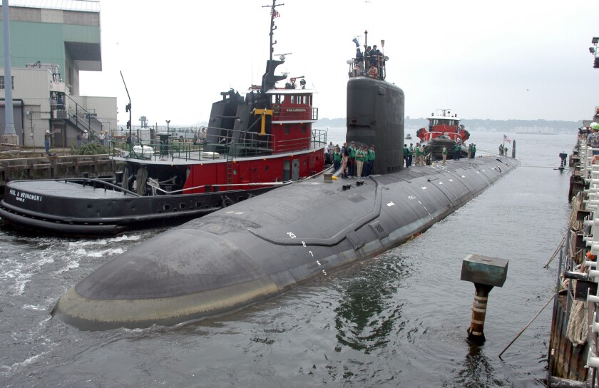 FILE - In this Friday, July 30, 2004 file photo, the U.S.S. Virginia returns to the Electric Boat Shipyard in Groton Conn., after its first sea trials. A Navy nuclear engineer with access to military secrets has been charged with trying to pass information about the design of American nuclear-powered submarines to someone he thought was a representative of a foreign government but who turned out to be an undercover FBI agent, the Justice Department said Sunday, Oct. 10, 2021. (AP Photo/Jack Sauer, File)
