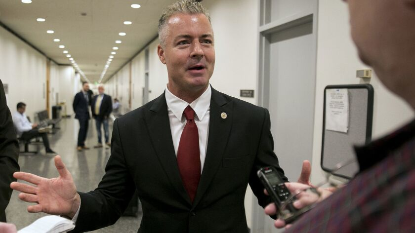 Assemblyman Travis Allen (R-Huntington Beach), a candidate for governor, speaks to reporters in Sacramento on Sept. 22, 2017.