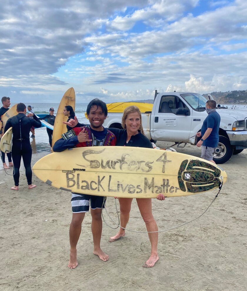Harley Sobreo and event organizer Leanne Tibiatowski attend the paddle-out at La Jolla Shores to support Black Lives Matter.
