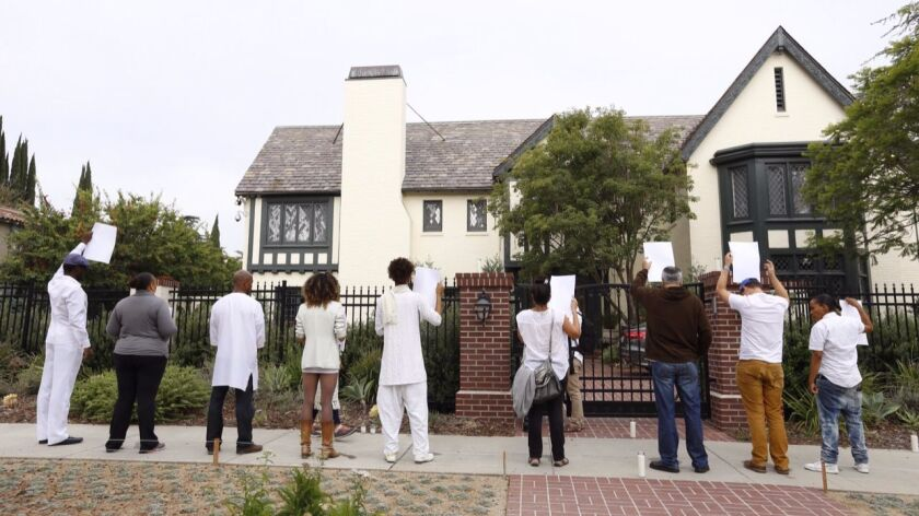About a dozen people protested outside Mayor Eric Garcetti's home during the summer of 2015, demandi