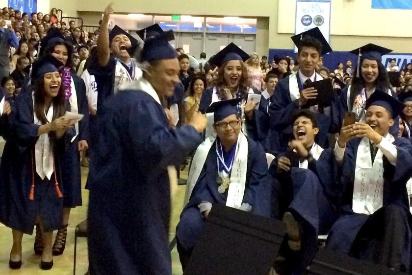 Students celebrate at a graduation at Mendez High School, named for human rights activist Sylvia Mendez.