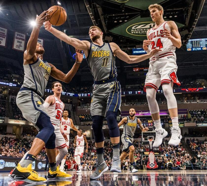 Chicago Bulls forward Lauri Markkanen of Finland (R) watches as Indiana Pacers forward Domantas Sabonis of Lithuania (C) and Indiana Pacers center Myles Turner (L) go for a rebound during the NBA game between the Chicago Bulls and the Indiana Pacers at Bankers Life Fieldhouse in Indianapolis, Indiana, USA, 04 December 2018. EPA-EFE/TANNEN MAURY