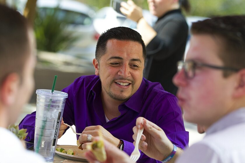 SAN DIEGO, CA-OCTOBER 14, 2015: |  Raymond Salas from Renovate America enjoys the company catered lunch at the office.  Renovate America employees enjoy daily provided catered lunch by their employer which feeds up to 500 company employees during lunch. | (Nelvin C. Cepeda / San Diego Union-Tribune