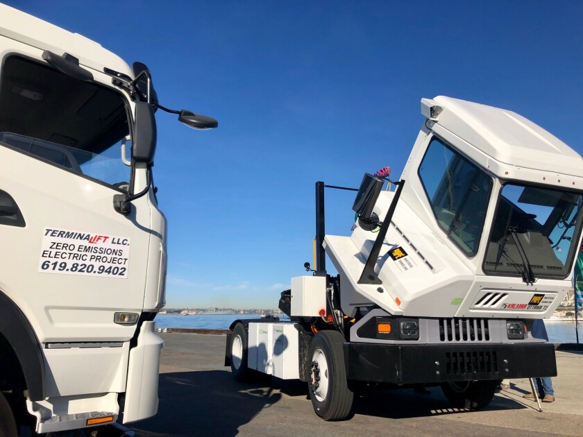 A TerminaLift zero-emissions electric-powered semi-truck, left, and a Kalmar Ottawa T2E electric terminal tractor on display at the Port of San Diego for the unveiling of the Clean Off-Road Equipment Voucher Incentive Project, known as CORE, on Friday, Jan. 31, 2020.
