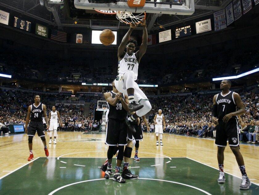 Milwaukee Bucks' Johnny O'Bryant III dunks during the second half of an NBA basketball game against the Brooklyn Nets Saturday, Nov. 7, 2015, in Milwaukee. The Bucks won 94-86. (AP Photo/Morry Gash)