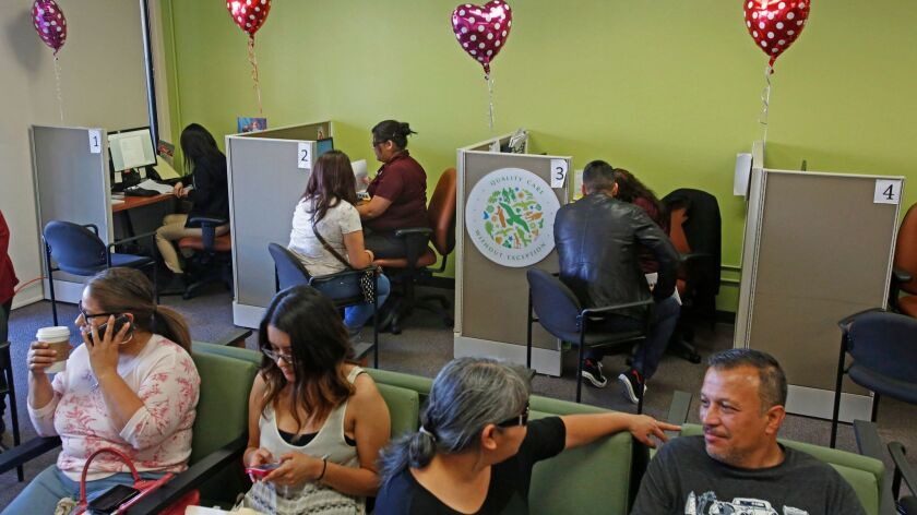 LOS ANGELES, CA. - FEBRUARY 14, 2015: People sign up for Obamacare at AltMed Health Services in Los