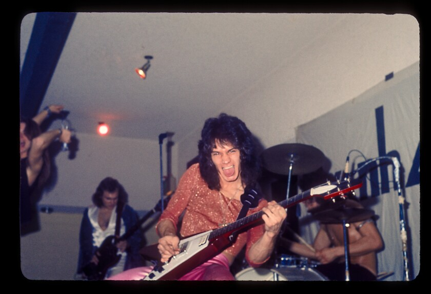 Eddie Van Halen shredding with his band in 1975.