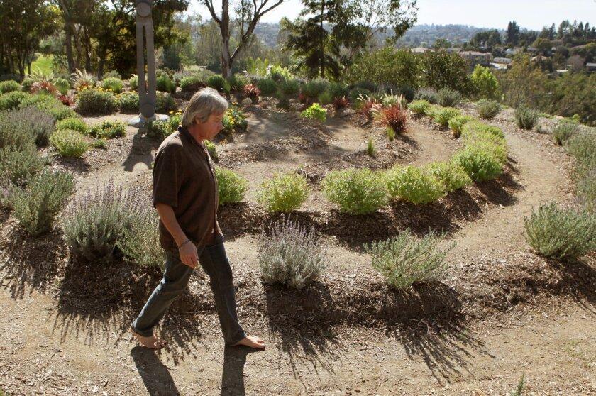 Bryan Morse walks through the Labyrinth in the Mediterranean Garden.