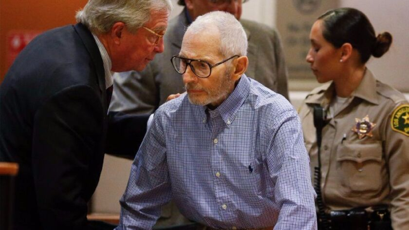 New York real estate scion Robert Durst, center, speaks with his attorney, Dick DeGuerin, at a previous court hearing. Durst appeared in a Los Angeles court this week for a hearing in his murder case.