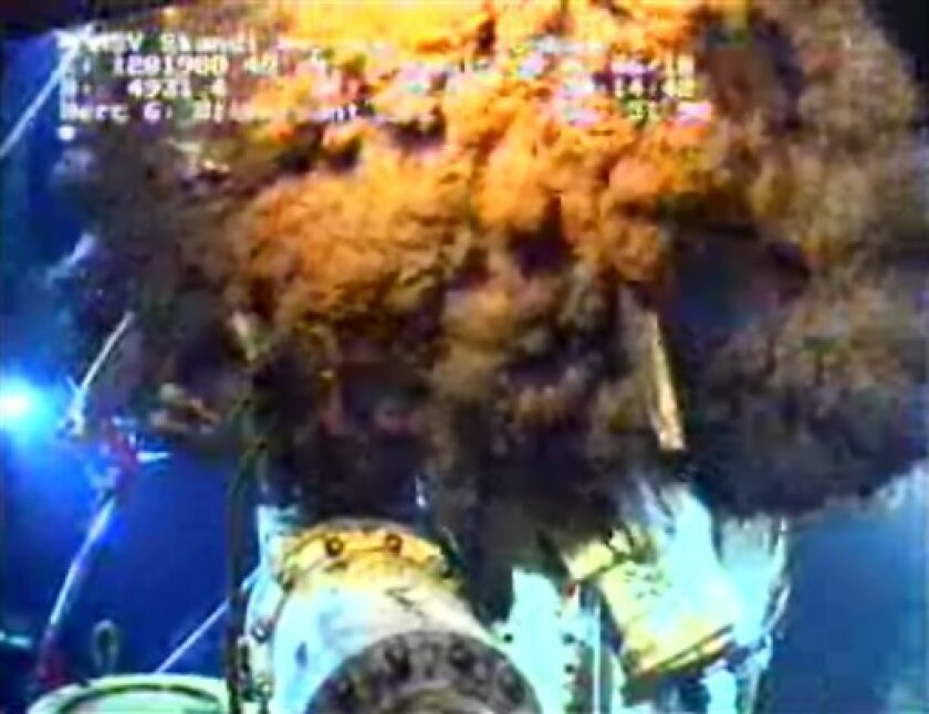 This image from video provided by BP PLC Sunday, June 6, 2010 shows the oil leak still pouring out of the well head around the capping device in the Gulf of Mexico. The containment cap was capturing more and more of the crude pouring from a damaged oil well in the Gulf of Mexico, but that bit of hope was tempered Sunday by a sharp dose of pragmatism as the federal government's point man warned the crisis could stretch into the fall. (AP Photo/BP PLC) NO SALES