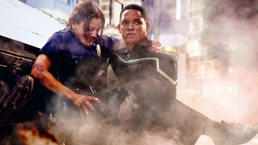 Hancock (Will Smith, right) saves the life of an injured female cop (Liz Wicker, left) before taking