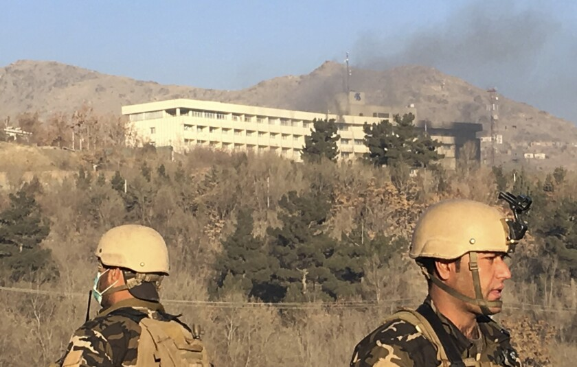Smokes rises from the Intercontinental Hotel after an attack in Kabul, Afghanistan, Jan. 21, 2018. Gunmen stormed the hotel in the Afghan capital on Saturday evening, triggering a shootout with security forces, officials said.