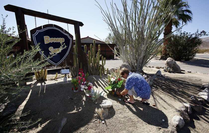 Thomas Antel leaves flowers outside the office of the Borrego Sun, where respected editor Judy Winter Meier worked.