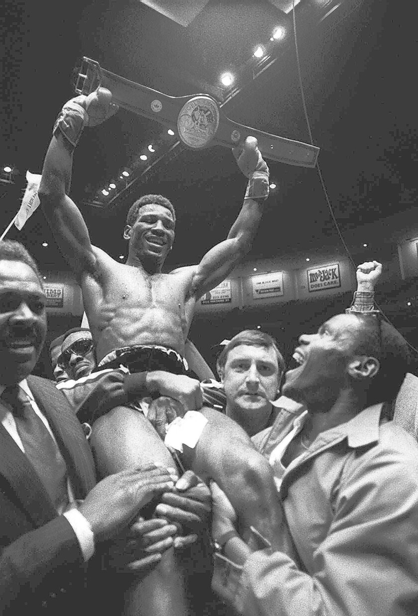 Matthew Saad Muhammad holds up his light-heavyweight title belt in 1980 after knocking out Lottie Mwale in San Diego.