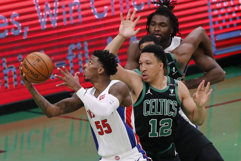 Detroit Pistons' Delon Wright (55) shoots against Boston Celtics' Grant Williams (12) during the second half of an NBA basketball game Friday, Feb. 12, 2021, in Boston. (AP Photo/Michael Dwyer)