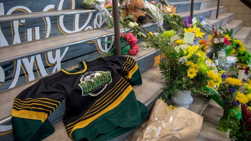 A memorial at the stairs that lead to Elgar Petersen Arena is shown in Humboldt, Saskatchewan, on Sa