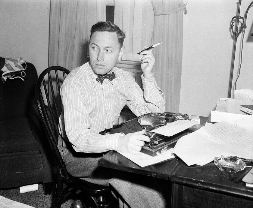 """FILE - This Nov. 11, 1940 file photo shows playwright Tennessee Williams at his typewriter in New York. A rarely seen Williams short story """"The Summer Woman"""" appears in the fall issue of the literary quarterly The Strand Magazine. (AP Photo/Dan Grossi, File)"""