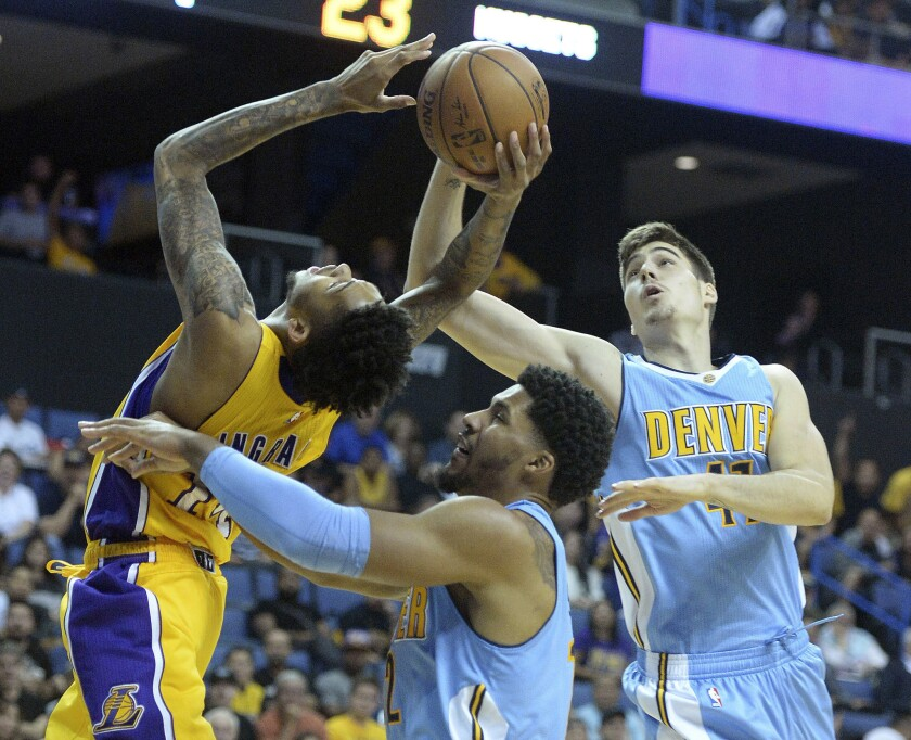 Lakers forward Brandon Ingram has the ball stripped away by Nuggets forward Juancho Hernangomez, right, during the first half of a preseason game in Ontario on Oct. 9.