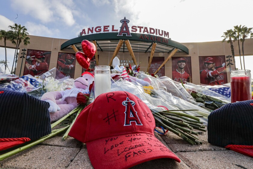 Fans leave flowers, hats and memorabilia at a memorial for Angels pitcher Tyler Skaggs outside Angel Stadium.