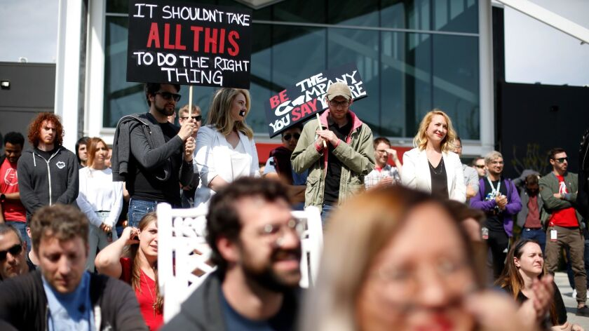 LOS ANGELES, CA-MAY 6, 2019: Workers at Riot Games listen to a speaker during a staged walk out at R