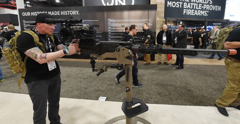 Kenneth Conkright of Colorado looks at a .50-caliber M2 machine gun at a 2018 trade show in Las Vegas.
