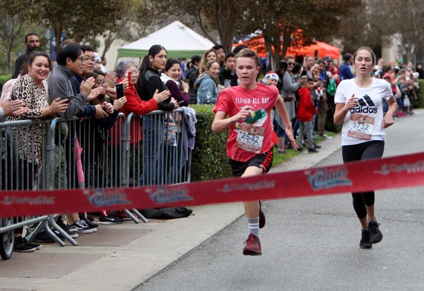 A boy and girl, both 12, near the finish line at a run in Rancho Santa Margarita.