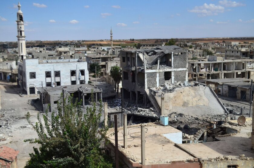 Deserted streets and damaged buildings in the central Syrian town of Talbisseh in Homs province. Russia confirmed Sept. 30 that it had carried out its first airstrike in Syria, near the city of Homs.