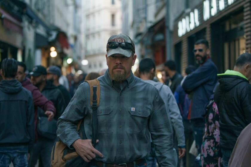 """Matt Damon walks down a city sidewalk in the movie """"Stillwater."""""""