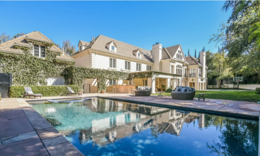 The two-story home holds six bedrooms, nine bathrooms, a movie theater and attic in over 10,000 square feet.