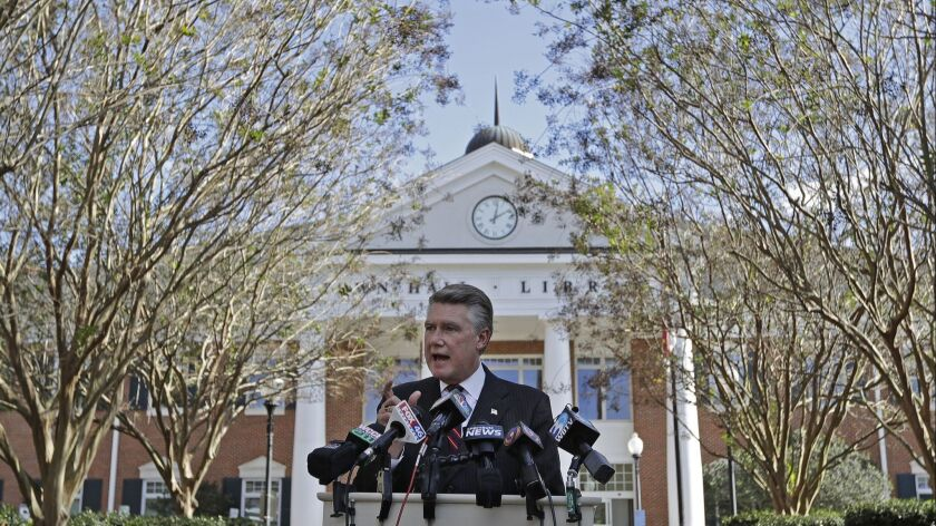 Republican Mark Harris speaks to the media in Matthews, N.C., the day after the midterm election.