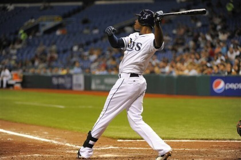 Tampa Bay Rays' B.J. Upton follows through on his swing as he hits a base-clearing double off of Baltimore Orioles pitcher Alfredo Simon to score teammates Desmond Jennings, Matt Joyce and Johnny Damon during the fifth inning of a baseball game, Saturday, Sept. 3, 2011, in St. Petersburg, Fla. (AP Photo/Brian Blanco)