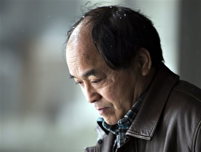 Daran Lin, father of murder victim Jun Lin, leaves the court after the end of the preliminary hearing for Luka Rocco Magnotta in Montreal on Friday, April 12, 2013. A judge ruled that Magnotta will stand trial on a charge of first degree murder in connection with the infamous body-parts case that m
