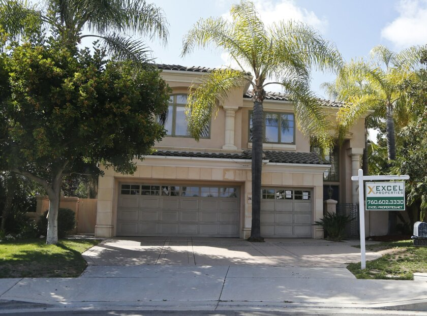 This Thursday, May 26, 2016, photo shows a home for sale in Carlsbad, Calif. The Standard & Poor's/Case-Shiller 20-city home price index for April is released on Tuesday, May 31, 2016. (AP Photo/Lenny Ignelzi)