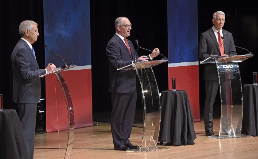 From left, Eddie Rispone, Gov. John Bel Edwards and Republican Rep. Ralph Abraham participate in the first televised gubernatorial debate Thursday Sept. 19, 2019, in Baton Rouge, La. (Bill Feig/The Advocate via AP, Pool)