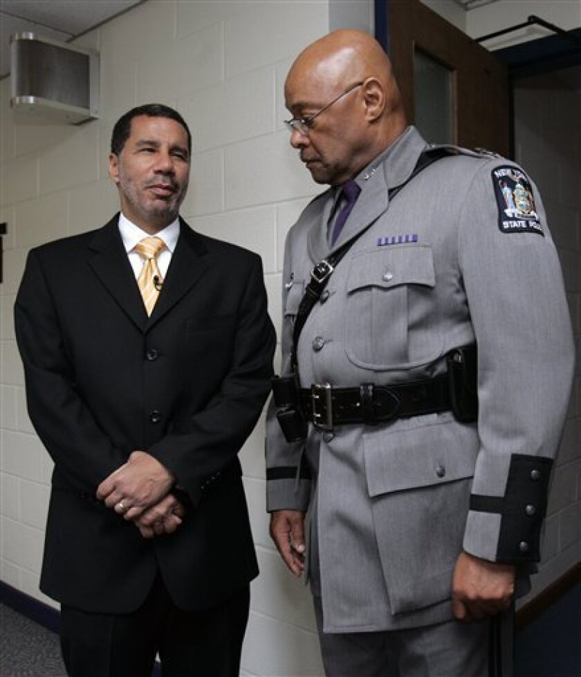 FILE - In this file photo taken May 27, 2008, New York Gov. David Paterson, left, talks with New York State Police Superintendent Harry Corbitt talk before Corbitt was sworn in at a ceremony in Albany, N.Y. Corbitt said Tuesday, March 2, 2010, that he was retiring from his position. (AP Photo/Mike Groll, File)