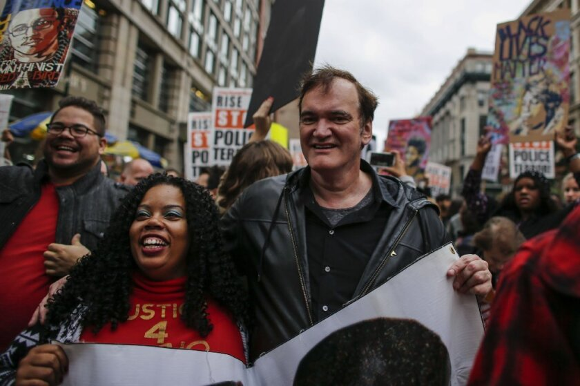 Quentin Tarantino marches in the Oct. 24 rally protesting police brutality.