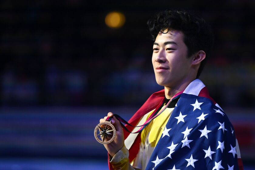 Nathan Chen poses with his medal after winning the men's free skate at the ISU Grand Prix of Figure Skating on Dec. 7 in Turin, Italy.