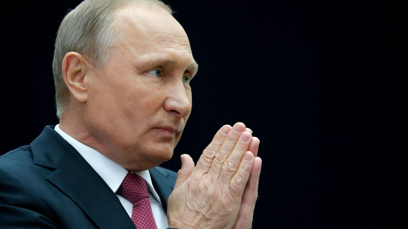 Russian President Vladimir Putin gestures speaking to the media after his annual live call-in show i