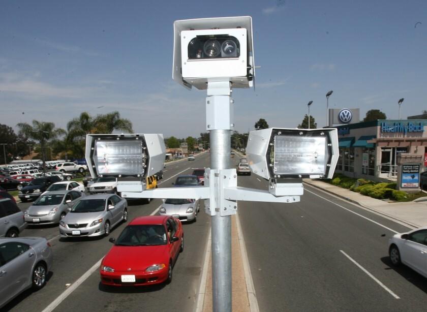 Red light cameras at the corner of Encinitas Blvd and El Camino Real in Encinitas.