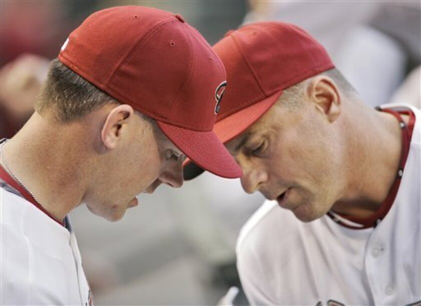 Arizona Diamondbacks manager A.J. Hinch, left, and third base coach Chip Hale speak prior to the teams' MLB baseball game against the Washington Nationals Friday, May 8, 2009 in Phoenix. (AP Photo/Matt York)